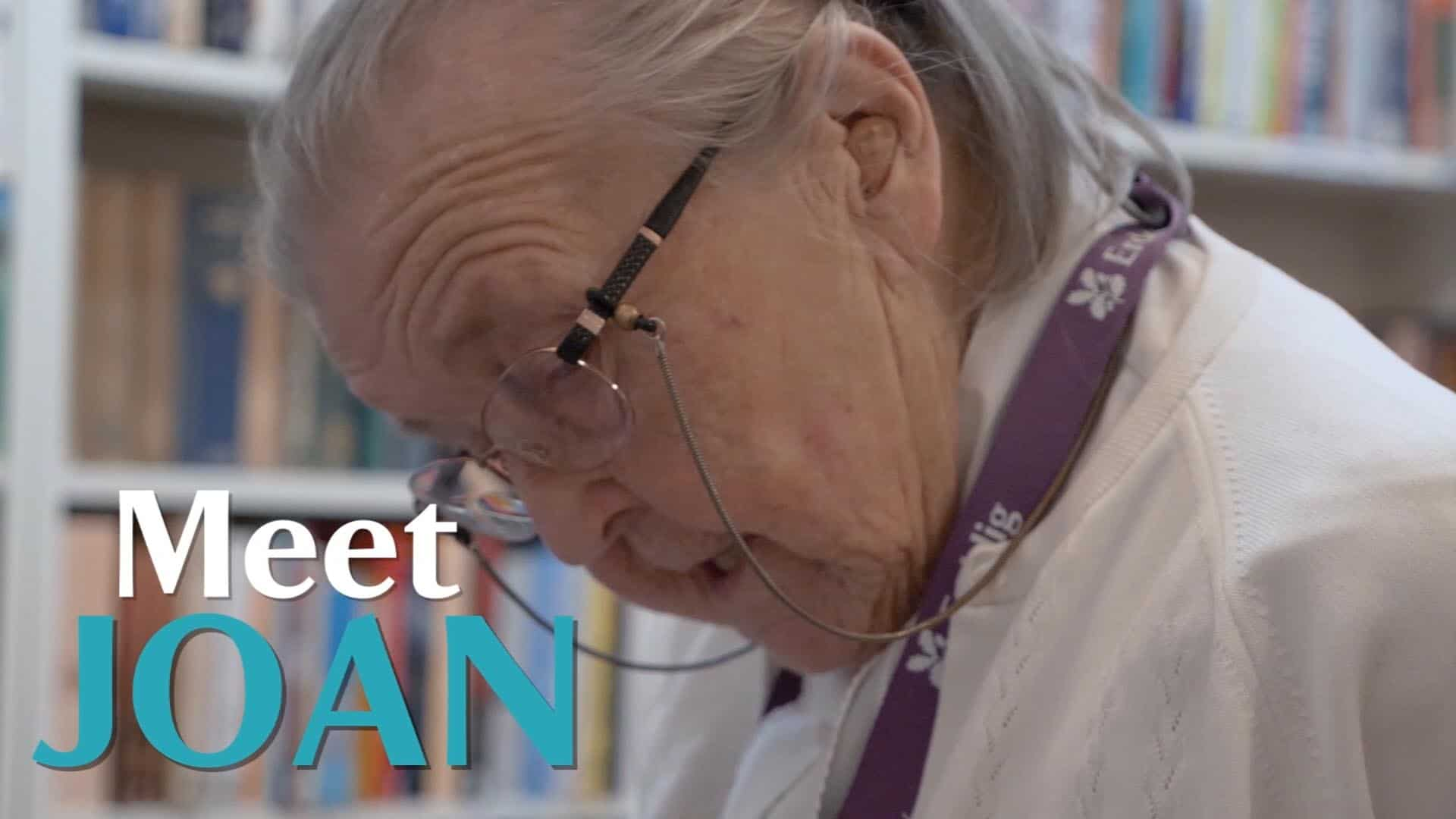 Screenshot from film of volunteer Joan with words 'Meet Joan' on screen